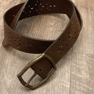 Punched leather brown belt with studded details
